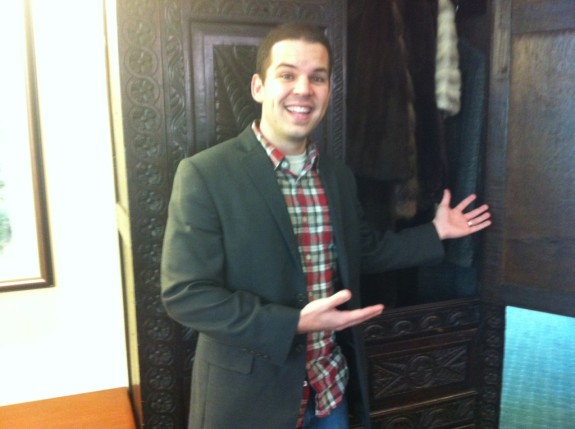 Me standing in front of C.S. Lewis' wardrobe. I peeked my head in the back, but was afraid to climb all the way in because.....